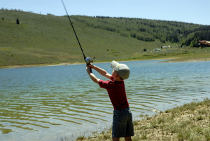 Young boy casting his line while fishing, location unspecified, July 4, 2007 | Photo courtesy of Division of Wildlife Resources, St. George News