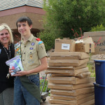 Jackson Ouzts, Wendi Bulkley and Benjamin Rae with emergency preparedness donations for the Washington City Community Center, Washington, Utah, May 20, 2015 | Photo by Nataly Burdick, St. George News