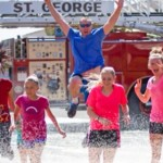 Racers run through the spray of a fire truck hose, location and date not specified | Photo courtesy of Fire Hose Frenzy, St. George News