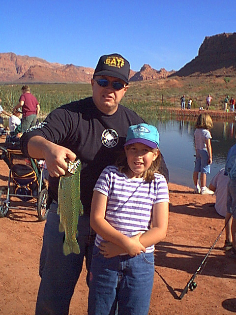 """Brett Barret with daughter on """"Free Fishing Day"""" in St. George, Utah, circa 2005 