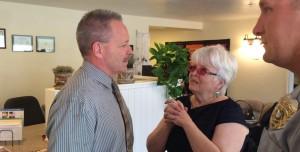 Washington City Police Chief Kim Kieth speaks with Sue Kimball visiting the new Erin Kimball home. Washington City, Utah, May 7, 2015 | Photo by Mori Kessler, St. George News