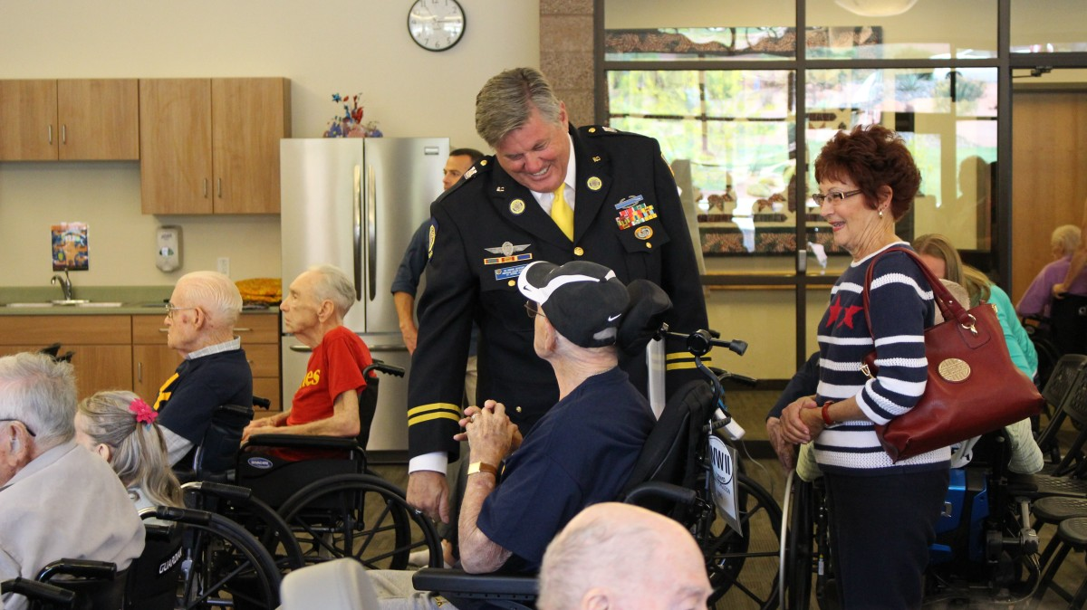 Ski Ingram, speaking to one of the veteran-residents at the Southern Utah Veterans Home, following a Memorial Day program, Ivins, Utah, May 25, 2015 | Photo by Mori Kessler, St. George News