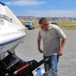 Division of Wildlife Resources conservation officers stop vehicles with boats on U.S. Highway 89 for quagga mussel inspection checkpoint, Big Water, Utah, May 13, 2015 | Photo by Heather Talley, courtesy of DWR, St. George News