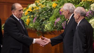 President Thomas S. Monson shakes the hand of Elder L. Tom Perry following the end of a session of general conference, Salt Lake City, Utah, April 2013 | Photo courtesy of The Church of Jesus Christ of Latter-day Saints, St. George News