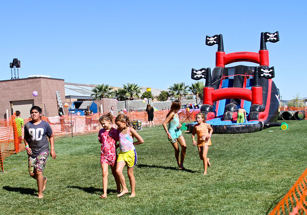 Children race after sliding down an inflatable during the Kids Adventure Challenge, St. George, Utah, October 3, 2014 | Photo courtesy of Kids Adventure Challenge, St. George News