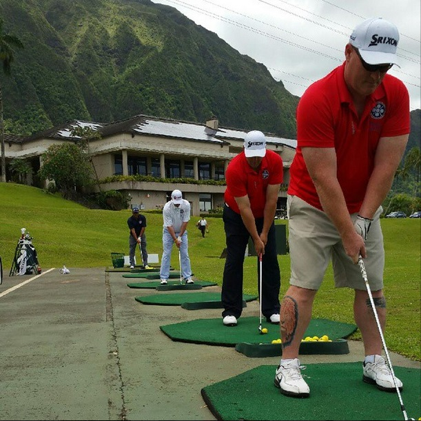 """""""Rounds Fore Warriors"""" golfers at the driving range in Hawaii Sunday morning at Ko'ohau Golf Course, Kaneohe, Hawaii, May 28, 2015 