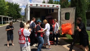 Red Cross staff and volunteers gather at the Red Cross van relief van to discuss the morning's canvassing, Washington City, Utah, May 16, 2015 | Photo by Mori Kessler, St. George News