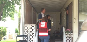 Red Cross volunteers asking a King's Row Estates resident if he needs new smoke alarms, Washington City, Utah, May 16, 2015 | Photo by Mori Kessler, St. George News
