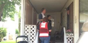 Red Cross volunteers asking a King's Row Estates resident if he needs new smoke alarms, Washington City, Utah, May 16, 2015 | Photo by Mori Kessler, St. George News