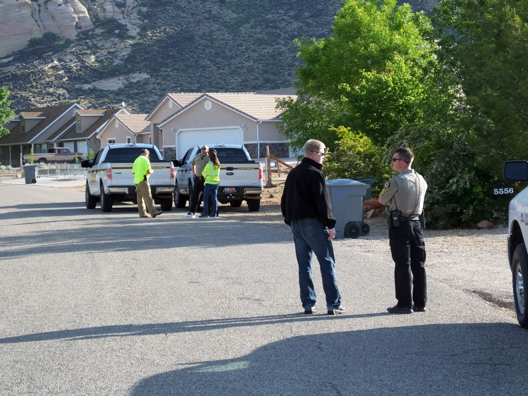 National Guard personnel and Washington County Sheriff deputies keep watch over a Winchester Hills street during a voluntary evacuation due to a search for unexploded munitions, Winchester Hills, Utah, May 11, 2015 | Photo courtesy of Jon Duckworth, St. George News