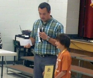 XXX from AAA presents Tyler Sunyich with h is award for AAA safety patroller Friday May 1, 2015 | Photo by Ric Wayman, St. George News