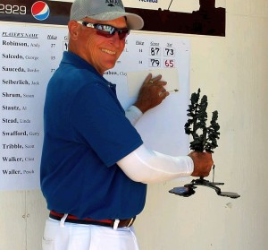 Texan Jim Wilson holds his trophy after winning the Mesquite Amateur golf tournament, Mesquite, Nevada, Friday, May 29, 2015   Photo by Ric Wayman, St. George News