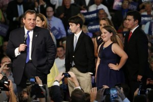 New Jersey Gov. Chris Christie stands with his wife, Mary Pat Christie, second from left, and their children, from left, Patrick, Sarah, Bridget and Andrew while speaking to supporters during an event announcing he will seek the Republican nomination for president, Tuesday, June 30, 2015, at Livingston High School in Livingston, N.J. | Photo by AP Julio Cortez, St. George News