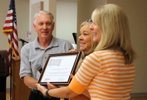 "L-R Dave Chapman, instructor, Jeanie Johnson, Senior Center Supervisor, and Linda Martin, office manager accept the AARP ""Top State Host"" award, St. George, Utah, June 19, 2015 