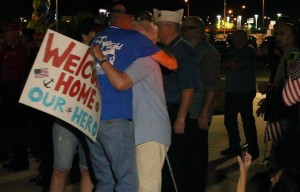 Veterans hug their loved ones after disembarking from the bus that brought the Utah Honor Flight home from the airport, St. George, Utah, June 6, 2015 | Photo by Leanna Bergeron, St. George News
