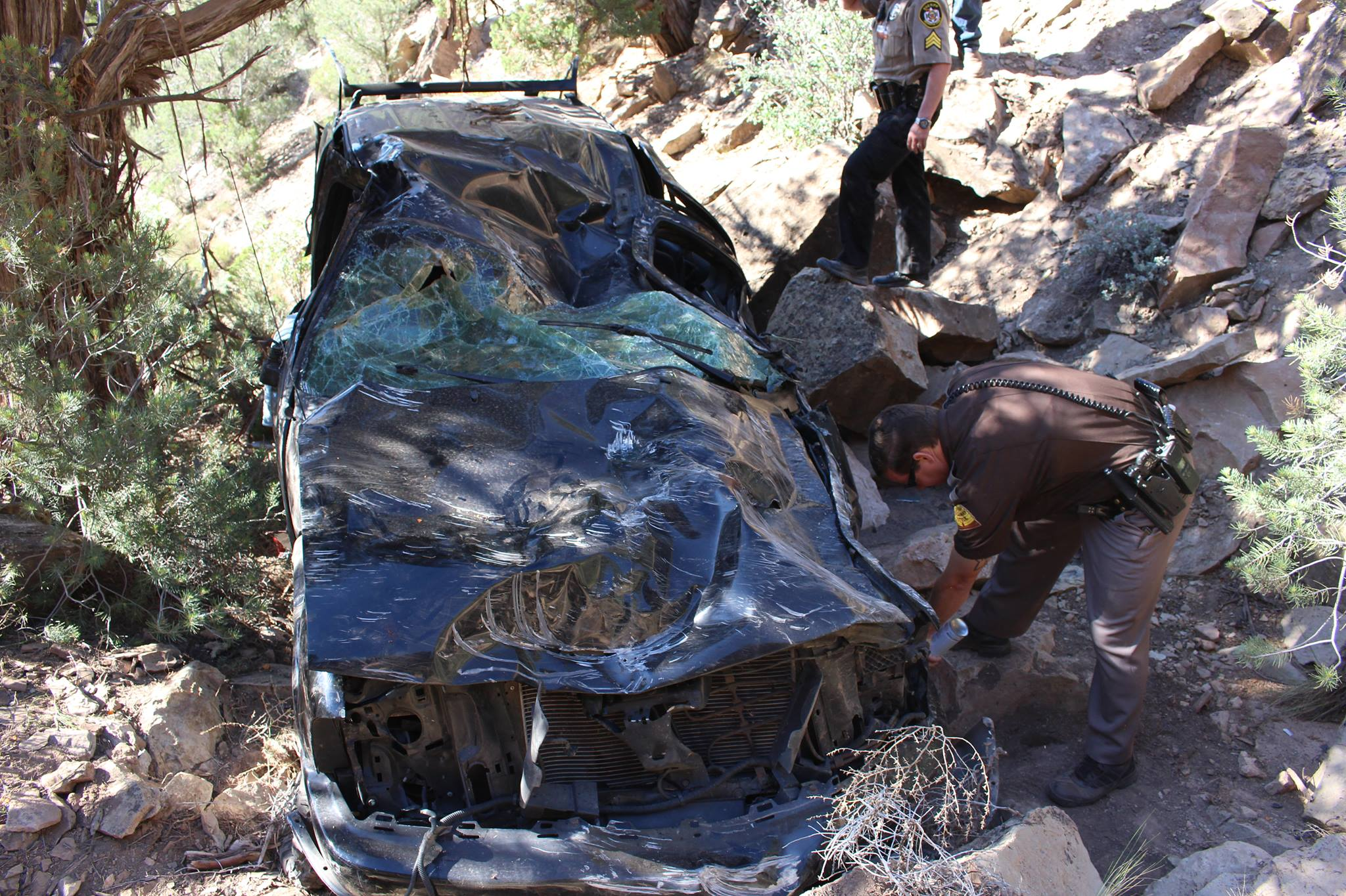 Vehicle at the bottom of ravine near Toquerville Falls; crash involved one fatality and one survivor, Toquerville area, Utah, June 8, 2015 | Photo by Sheldon Demke, St. George News