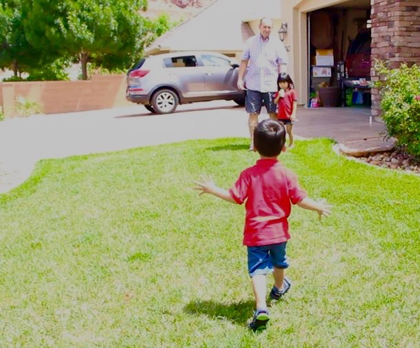 Enoch Neaville runs to his dad, Kyle Neaville and sister Lily Neaville, St. George, Utah, June 6, 2015   Photo by Nataly Burdick, St. George News