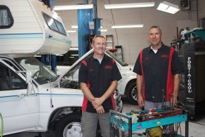 (L-R) Evan Jenkins and Sonny Cheser in Pro Auto Care shop, July 2, 2015, St. George, UT | Photo by Sheldon Demke, St. George News