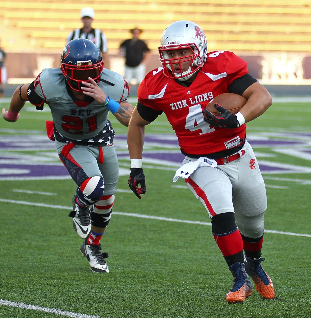 Matt Fuela (4) carries the ball for the Lions during last year's championship game, Zion Lions vs. Wasatch Revolution, Ogden, Utah, June 27 2015, | Photo by Robert Hoppie, ASPpix.com, St. George News