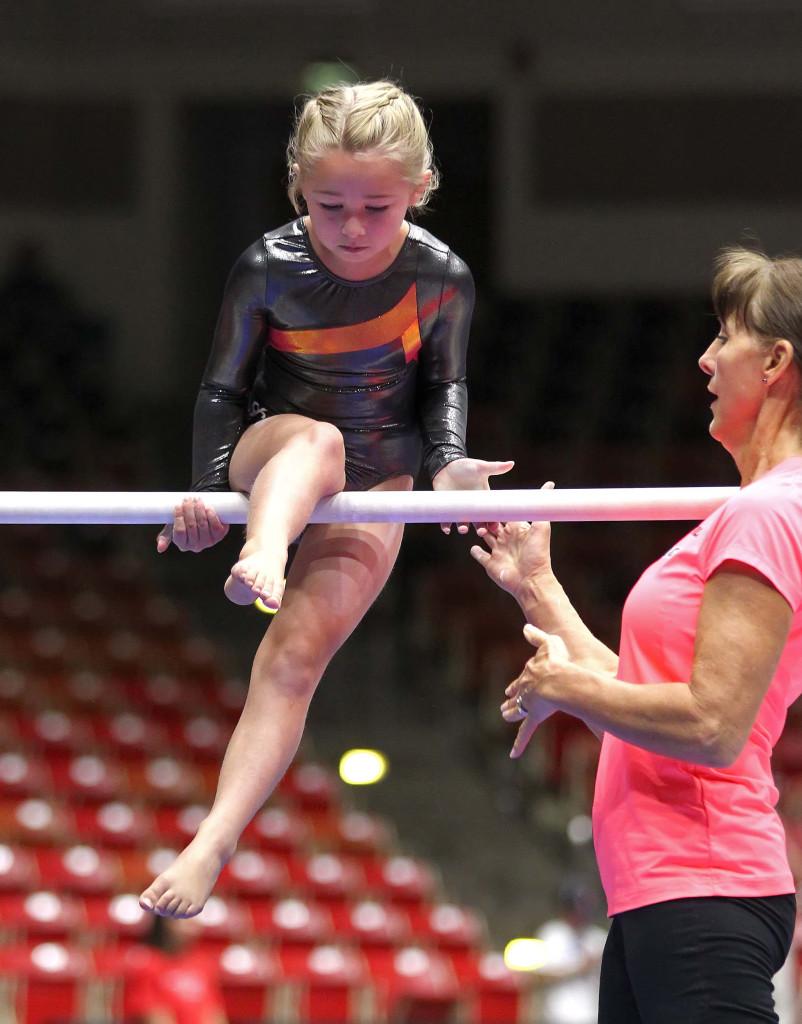 Sadie Gunther is helped by coach Beth Julian, Utah Summer Games, Gymnastics, Cedar City, Utah, June 13, 2015, | Photo by Robert Hoppie, ASPpix.com, St. George News