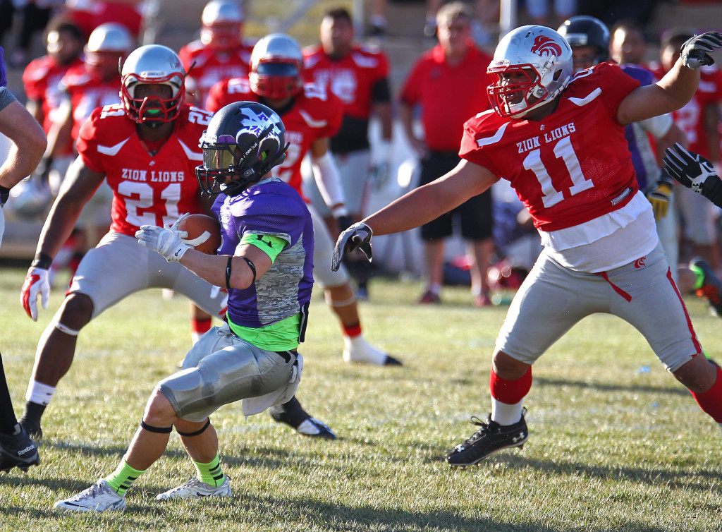 Lion defenders Doug Roberts (11) and Brandon Thompson (21) track down the Sting ball carrier, Zion Lions vs. Brigham Sting, Foorball, St. George, Utah, June 13, 2015,   Photo by Robert Hoppie, ASPpix.com, St. George News