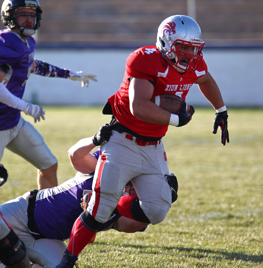 Lions running back Matt Feula (4) breaks a tackle, Zion Lions vs. Brigham Sting, Foorball, St. George, Utah, June 13, 2015, | Photo by Robert Hoppie, ASPpix.com, St. George News