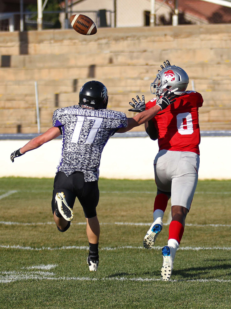Zion wide receiver Chad Ford (8) reaches out to grab a long pass and scores a touchdown in the first quarter, Zion Lions vs. Idaho Mustangs, Football, St. George, Utah, June 20, 2015, | Photo by Robert Hoppie, ASPpix.com, St. George News