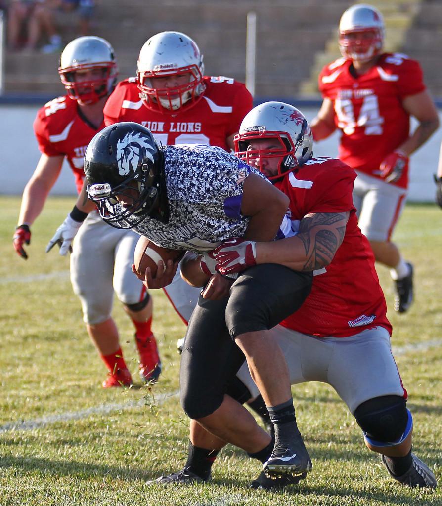 Joe Feula pulls down  Mustang quarterback in the backfield, Zion Lions vs. Idaho Mustangs, Football, St. George, Utah, June 20, 2015, | Photo by Robert Hoppie, ASPpix.com, St. George News