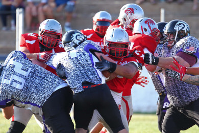 The Lions defense swarms the Mustang ball carrier, Zion Lions vs. Idaho Mustangs, Football, St. George, Utah, June 20, 2015, | Photo by Robert Hoppie, ASPpix.com, St. George News