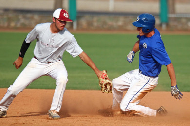 Dixie's Kade Christensen slides in under the tag of Cedar City's Travis Tate, Dixie vs. Cedar, Baseball, St. George, Utah, June 26, 2015, | Photo by Robert Hoppie, ASPpix.com, St. George News