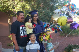 Maria Silva celebrates with her family after the graduation ceremony for Stevens-Henager St. George Campus, St. George, Utah, June 2, 2015 | Photo by Hollie Reina, St. George News
