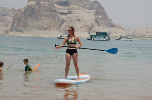 The author learning to stand-up paddleboard at Wahweap Beach, Page, Arizona, June 19, 2015 | Photo by Ralph Reina, St. George News