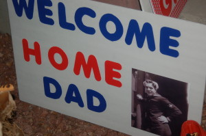 Families bring welcome home signs to greet their loved ones as they return from the Utah Honor Flight trip, St. George, Utah, June 6, 2015 | Photo by Hollie Reina, St. George News