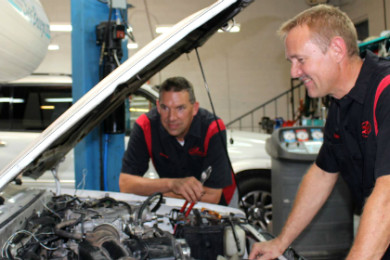L-R: Evan Jenkins and Sonny Cheser in Pro Auto Care shop, St. George, Utah, July 2, 2015 | Photo by Sheldon Demke, St. George News