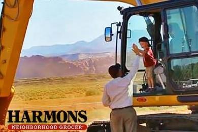 Bob Harmon, vice president of Harmons Neighborhood Grocer, gives grandson a high five breaking ground for new new store, Santa Clara, Utah, June 22, 2015 | Photo by Sheldon Demke, St. George News