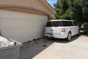 The driver of an SUV crashed into a truck and then a home after failing to stop at a stop sign, Hurricane, Utah, June 15, 2015   Photo by Jessica Tempfer, St. George News