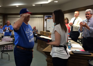 Utah Honor Flight committee member Ron Lewis hands off the 13-star flag and a certificate of authenticity to Mayor Maile Wilson saluting her before he turns away, Cedar City Council Chambers, Cedar City, Utah, June 17, 2015 | Photo by Carin Miller, St. George News