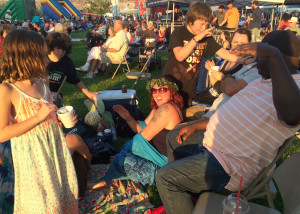 Lounging at the park enjoying the music at the Groovefest Music and Art Festival, Main Street Park, Cedar City, Utah, June 27, 2015 | Photo by Carin Miller, St. George News