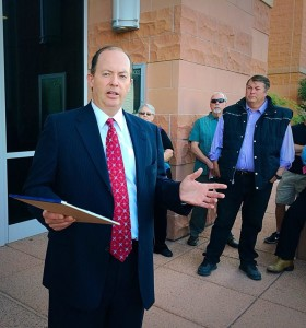 Attorney Mark James explains the details of an auction for Warren Jeffs' Cadillac Escalade on the steps of the 5th District courthouse, St. George, Utah, June 15, 2015 | Photo by Kimberly Scott, St. George News