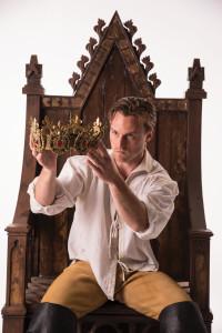 Actor examining a crown, Cedar City, Utah, undated | Photo courtesy of Utah Shakespeare Festival, St. George News
