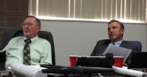 Iron County Commissioners Dale Brinkerhoff (left) and David Miller (right) talk with Iron County Attorney Scott Garrett about the possible effects the new law could have, Parowan, Utah, June 22, 2015 | Photo by Devan Chavez, St. George News