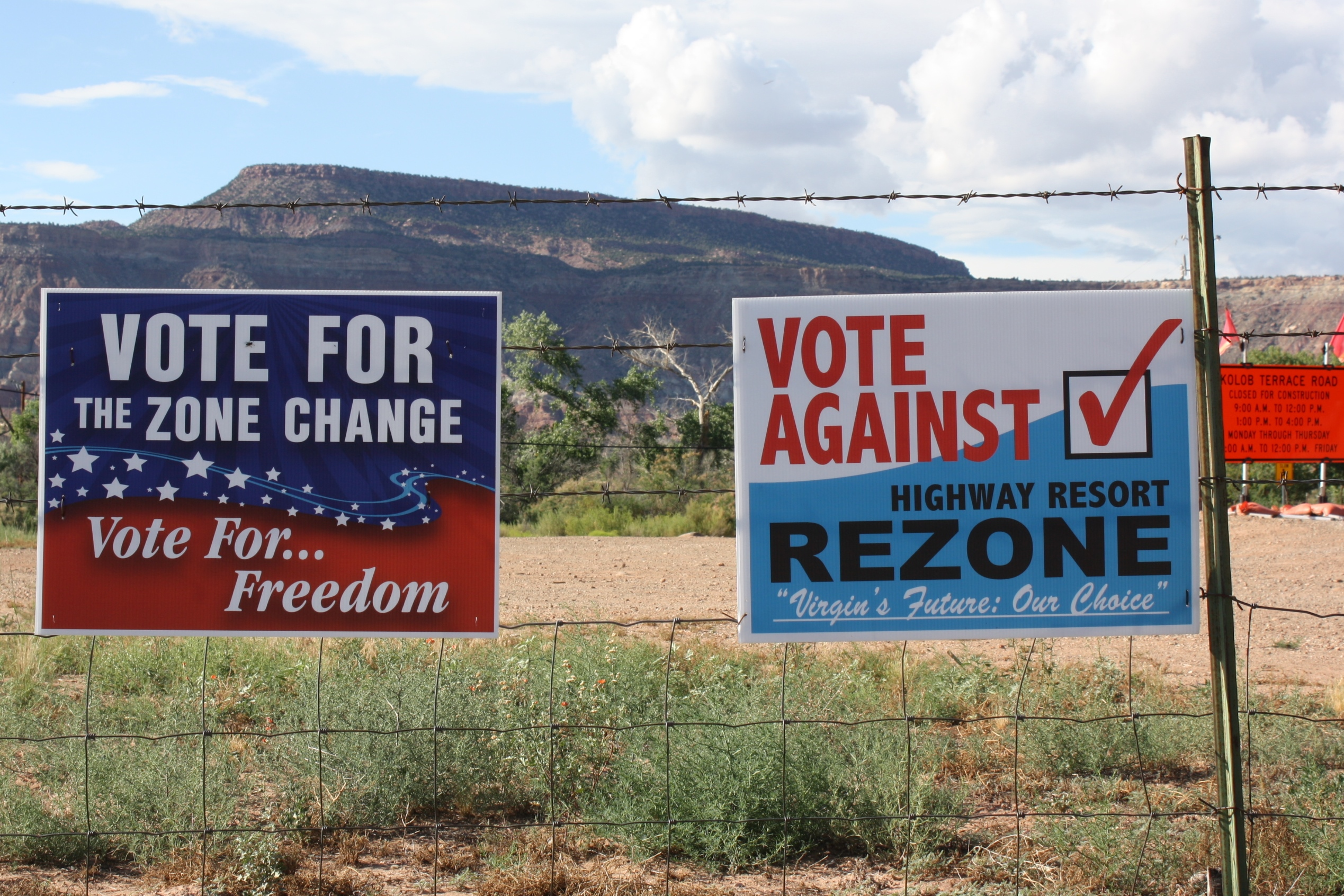 Two referendum signs urging Virgin residents to vote on the June 23 referendum on a fence next to the turnoff of the Kolob Terrace Road, Virgin, Utah,  June 11, 2015 | Reuben Wadsworth, St. George News