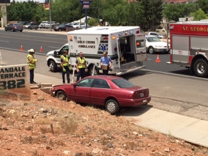 A drowsy driver crashed into a concrete barrier on Bluff Street, sending her to the hospital, St. George, Utah, June 23, 2015 | Photo courtesy of Tyler Truman, St. George News