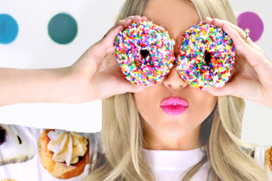Ali Hill celebrating National Donut Day at St. George News, June 5, 2015 | Photo by Devan Chavez, St. George News