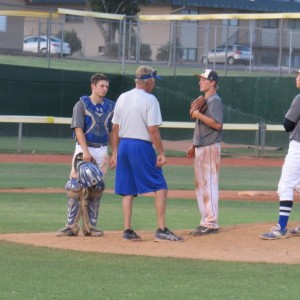 Dixie has a meeting at the mound, Dixie vs. Springville, American Legion Tourney, St. George, Utah, Jun. 27, 2015 | Photo by Darren Cole, St. George News