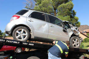 Damage to a Suzuki SX4 after it crashed into a brick wall and house, St. George, Utah, June 2, 2015 | Photo by Nataly Burdick, St. George News