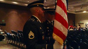 Staff Sgt. Todd Allen does double duty as flag bearer and graduate during the commencement ceremony for the 2015 graduating class of Stevens-Henager College St. George Campus, St. George, Utah June 2, 2015 | Photo by Hollie Reina, St. George News