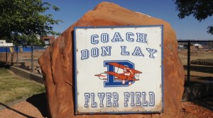 A large rock bearing the name of Coach Don Lay Flyer Field sits just outside the fence of where the field, now torn down, used to exist, St. George, Utah, June 16, 2015 | Photo by Hollie Reina, St. George News