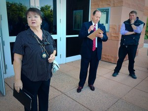 Washington County Constable Jean Dickson presides over an auction for Warren Jeffs' Cadillac Escalade on the steps of the 5th District courthouse, St. George, Utah, June 15, 2015 | Photo by Kimberly Scott, St. George News