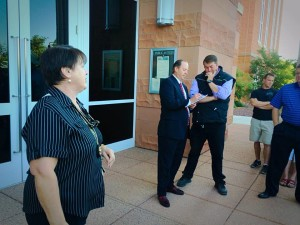Willie Jessop and his attorney Mark James discuss bids during an auction for Warren Jeffs' Cadillac Escalade on the steps of the 5th District courthouse, St. George, Utah, June 15, 2015 | Photo by Kimberly Scott, St. George News